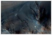 Rocky Layers and Valley Networks in Syrtis Major