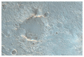 Small Crater and Mesa Northeast of Hellas Region