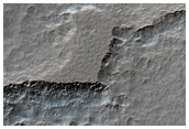 Dissected Mantle Terrain South of Hellas Region