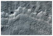 Fresh Crater on Edge of South Polar Layered Deposits
