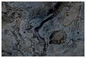 Fluvial Channels along Melas Chasma Wallrock