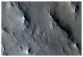 Ejecta Flow Around Topographic Obstacle in East Elysium Planitia