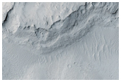Cemented and Cratered Dunes at the Margin of Apollinaris Sulci