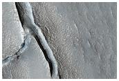 Pair of Odd Craters of Hrad Vallis Deposit
