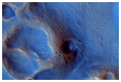 Unusual Dark Albedo Feature in A Dust-Starved Area