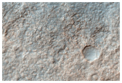 Big Crater in Hellas Basin with Channels Flowing In and Out