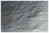 Flow Ejecta From Large Crater in Savich Crater Basin