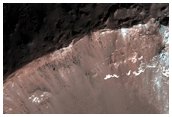 Fresh Crater with Both Light-Toned Outcrops and Gullies