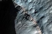 Gullies and Light-Toned Outcrops in Crater Wall