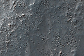 Small Cratered Terrain Outflow Channel System West of Bond Crater