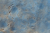 Light-Toned Unit Being Exhumed from Overlying Mantle in Arabia Terra