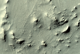 Layered Deposits within Unnamed Crater in Arabia Terra