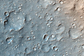 Dark Wind Streaks and Dust Devils in Gusev Crater