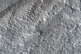 Interaction between Gullies and Mantle on Equator-Facing Slope