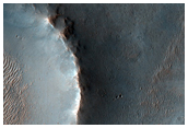 Impact Crater Ejecta on Terrain West of Ganges Chasma