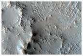 Outflow of Crater with Nili Fossae Fan and Phyllosilicates