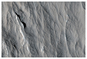 Layered Materials and Blocks in Olympus Mons Aureole