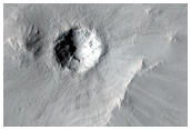 Large Cluster of Small Craters Near Maadim Vallis