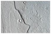 Emission of Dark Material in Cerberus Fossae