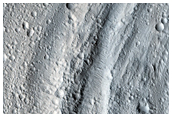 Dark Material and Crater in Ridge on Lobate Feature Near Olympus Mons