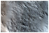 Slope Streaks and Material Slumping