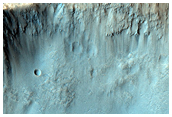 Central Uplift in a Large Impact Crater in Hesperia Planum