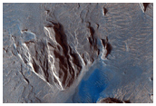 Dark Materials on Block in Olympus Mons Aureole