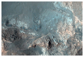 Megabreccia Deposits in Uzboi Vallis-Holden Crater Breech