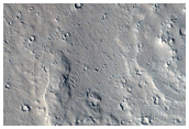 Terraces around Edge of Marte Vallis Cut by Water or Lava