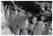 Ejecta of Crater Sectioned by Erosion