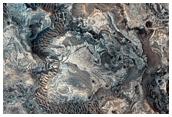 Valleys and Layering along Melas Chasma