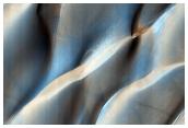 Colliding Sand Dunes in Aonia Terra