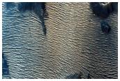 Dark Features in Candor Chasma