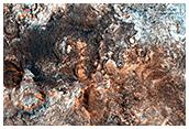 Light-Toned Outcrops Near Crater Rim in Arabia Terra