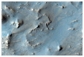 Possible Gullies in a Crater on the Rim of Baldet Crater