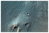 Floor and Wall Materials in Trough East of Holden Crater