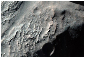 Crater with Perched Valleys in Claritas Fossae Region