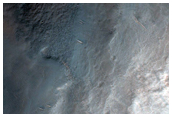Fresh Craters Overlying Grabens South of Pavonis Mons