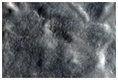 Flow Ejecta of Well-Preserved 12-Kilometer Diameter Crater