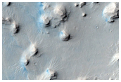 Layered Deposits in Crater in Western Arabia Terra