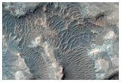 Valleys and Layering along Melas Region
