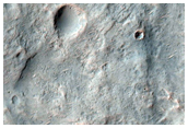 Crater Ejecta Overlapping Filled Crater