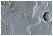 Dusty Lava Flows on Ascreaus Mons