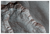 Scalloped Topography in Peneus Patera Crater