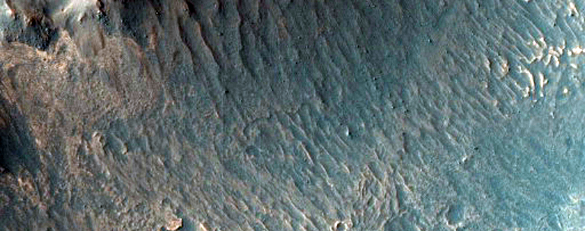 Valley Features and Light-Toned Deposits along Melas Region Southern Wall