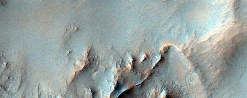 Light-Toned Bedrock Exposed in Walls and Central Peak of Crater