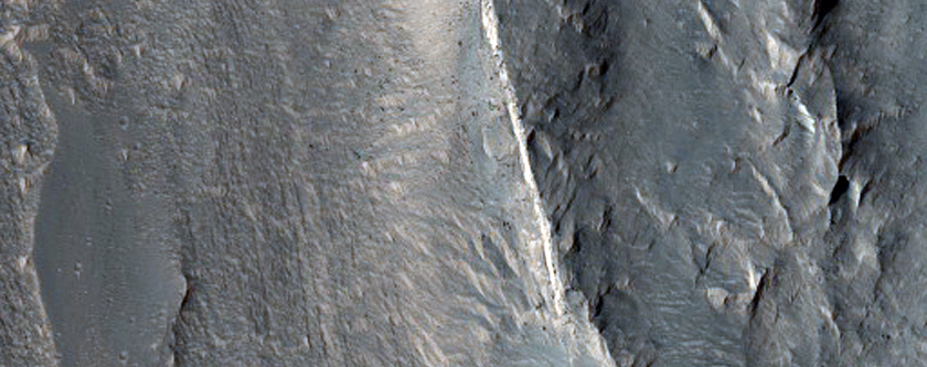 Wallrock and Light-Toned Layering Geologic Contact in Coprates Chasma