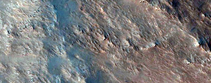Layered Bedrock Exposures in Massif North of Hellas Basin