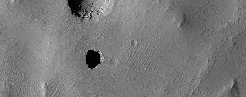 Incipient Pit Crater in the Arsia Chasmata