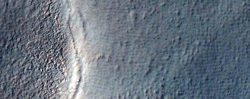 Crater in Icaria Fossae Region with Intersecting Graben